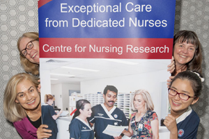 4 nurses posing with a Centre for Nursing Research banner