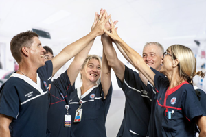 A group of health professionals high-fiving